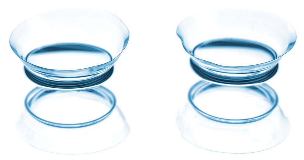 Two contact lenses with reflections.